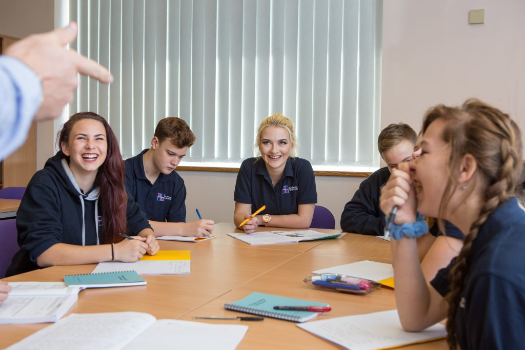 high school pupils in a lesson