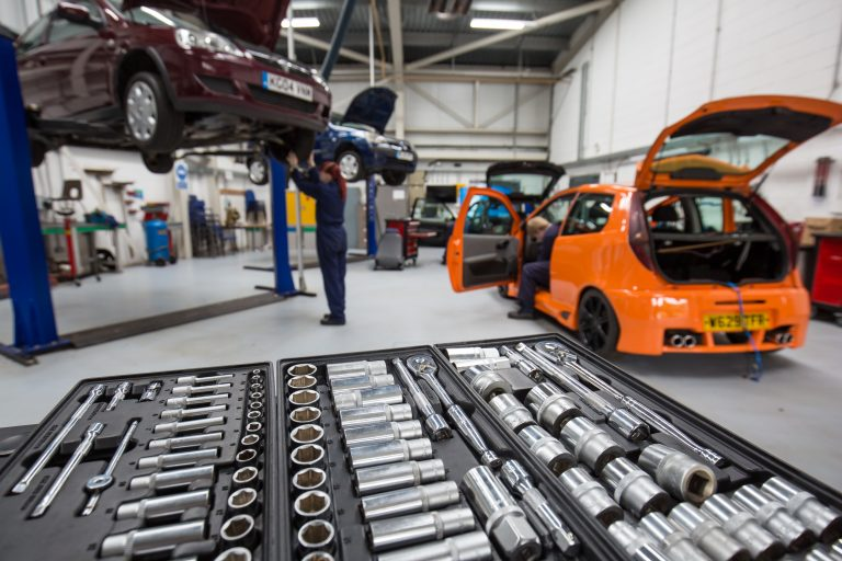 automotive workshop with orange car