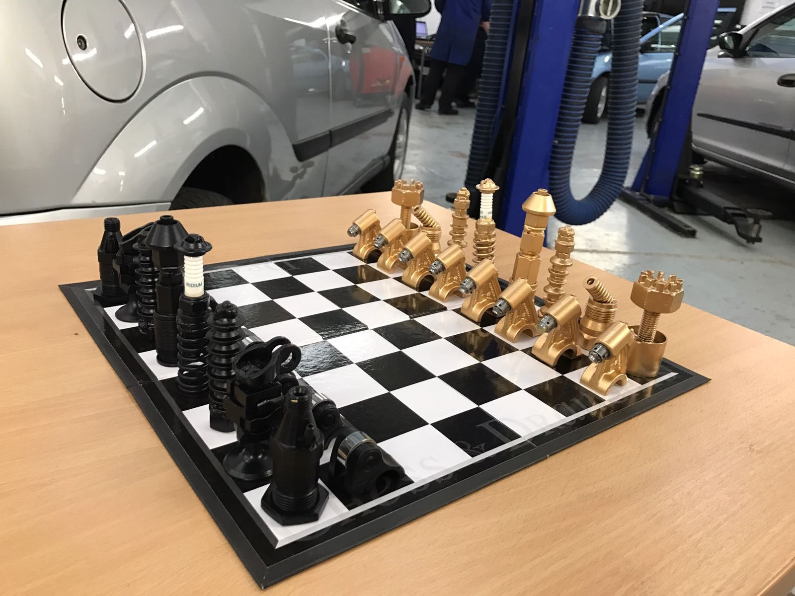 Chess board created with recycled car parts