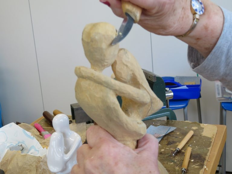 Woodcarving of a human figure