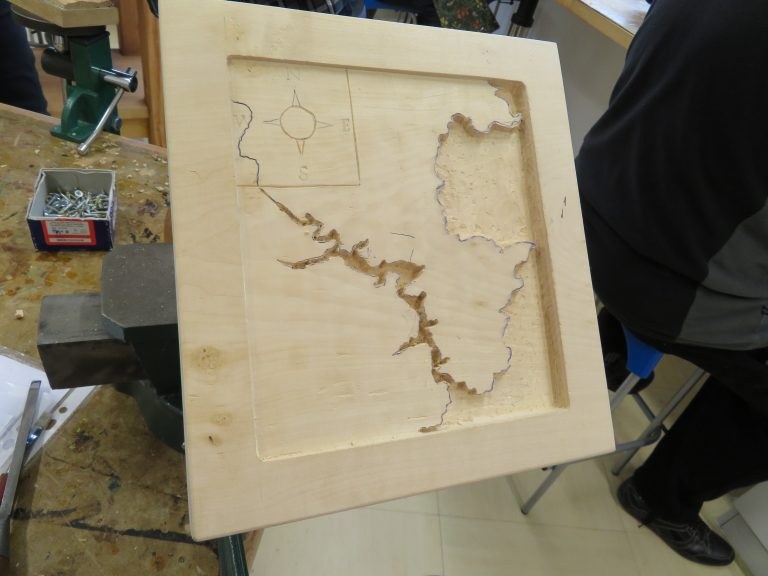 Woodcarving of a map of Torbay