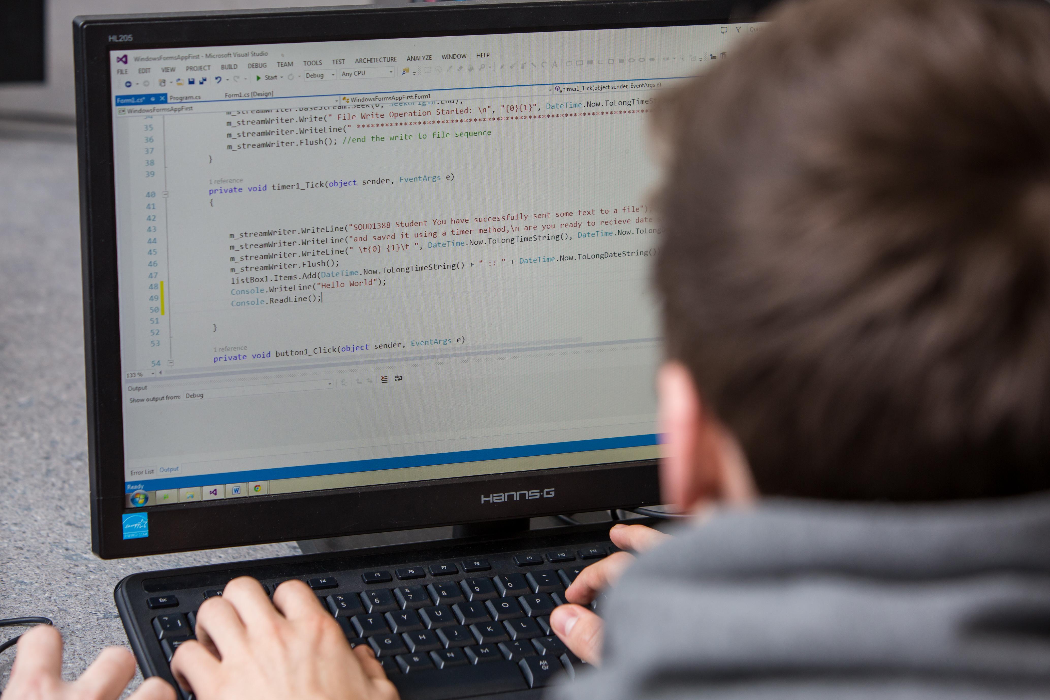 Student looking at computer monitor