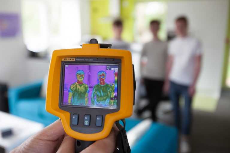 Student using a heat detection camera
