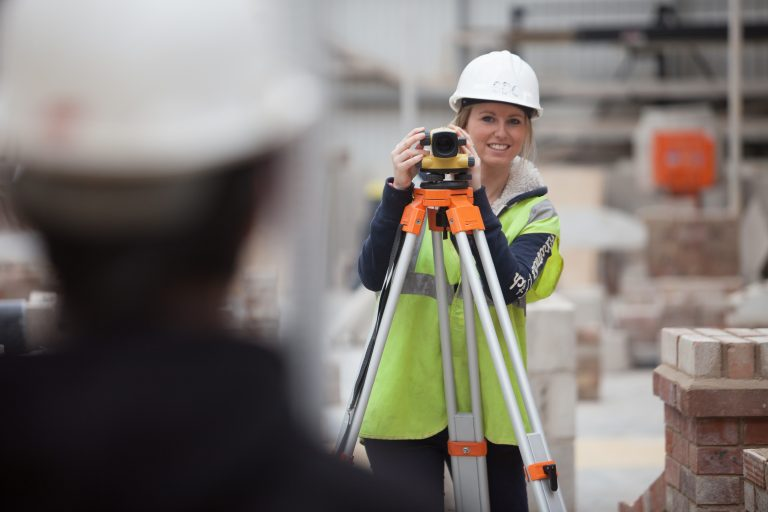 Girl using surveying equipment