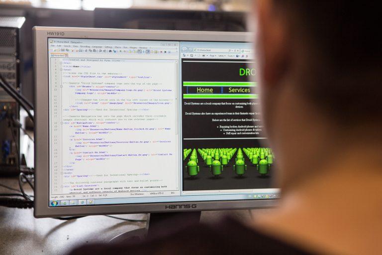 Student looking at computer monitor.