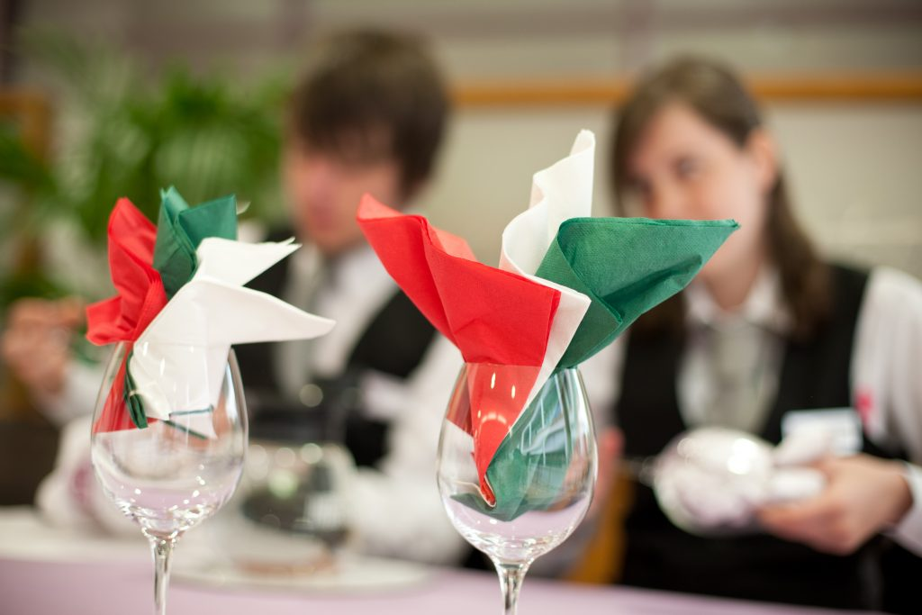 Students preparing glassware for an event