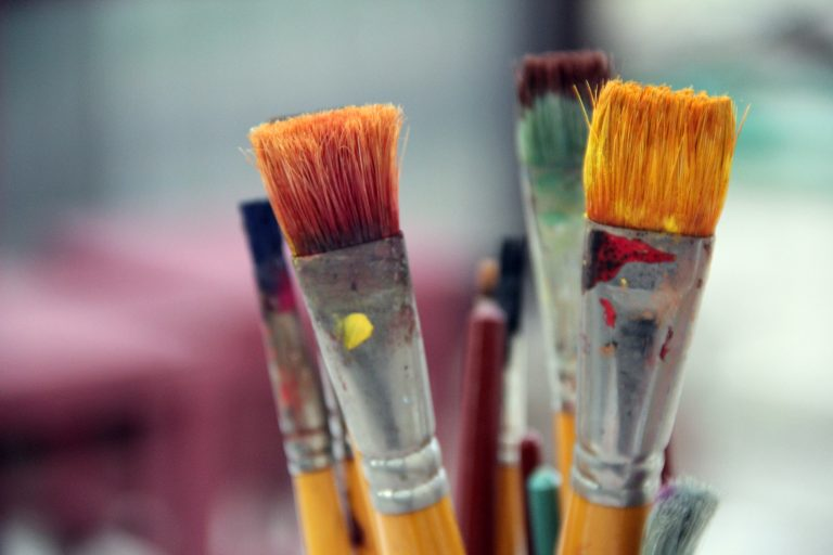 A close up of paint brushes.