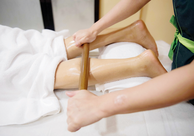 Client having a bamboo massage.