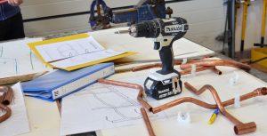 Makita drill on workstation.