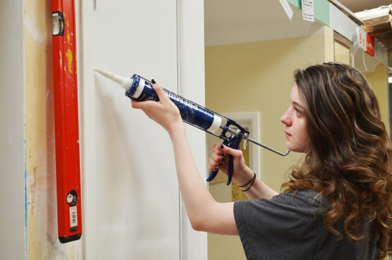 Student decorating the walls at our Newton Abbot Campus.