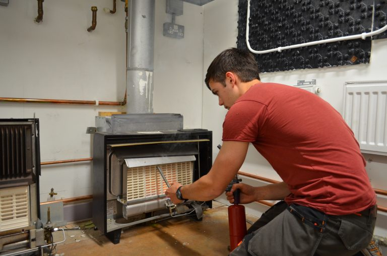 Student looking at heater as part of his HTR1 Heaters and Fires Re-assessment course.