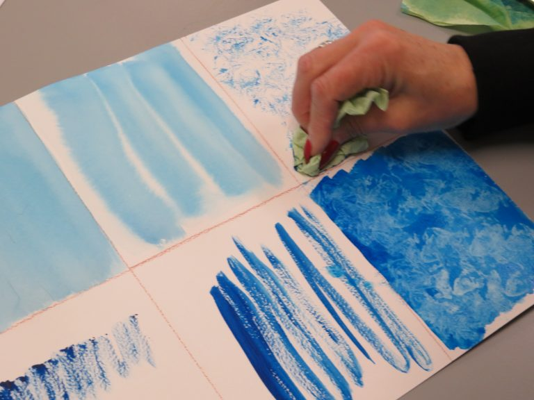 Student experimenting with watercolour techniques.