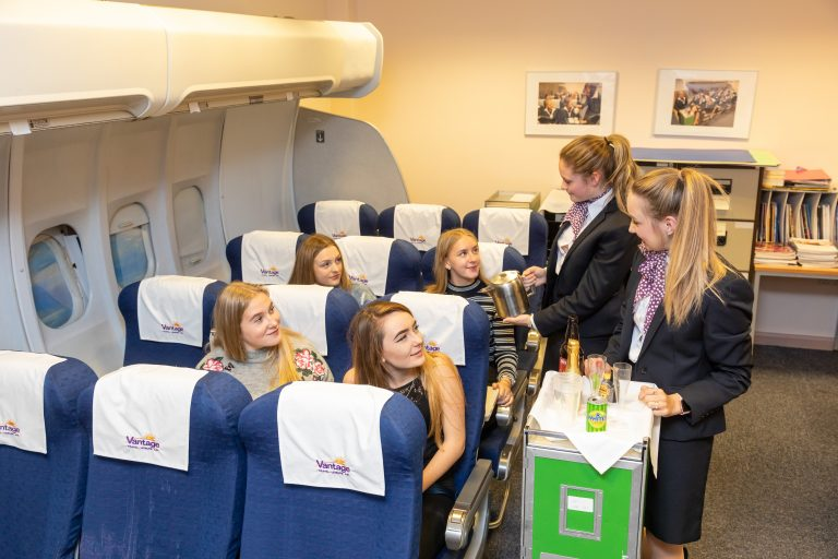 Travel and tourism students in the airplane classroom at our Paignton campus.