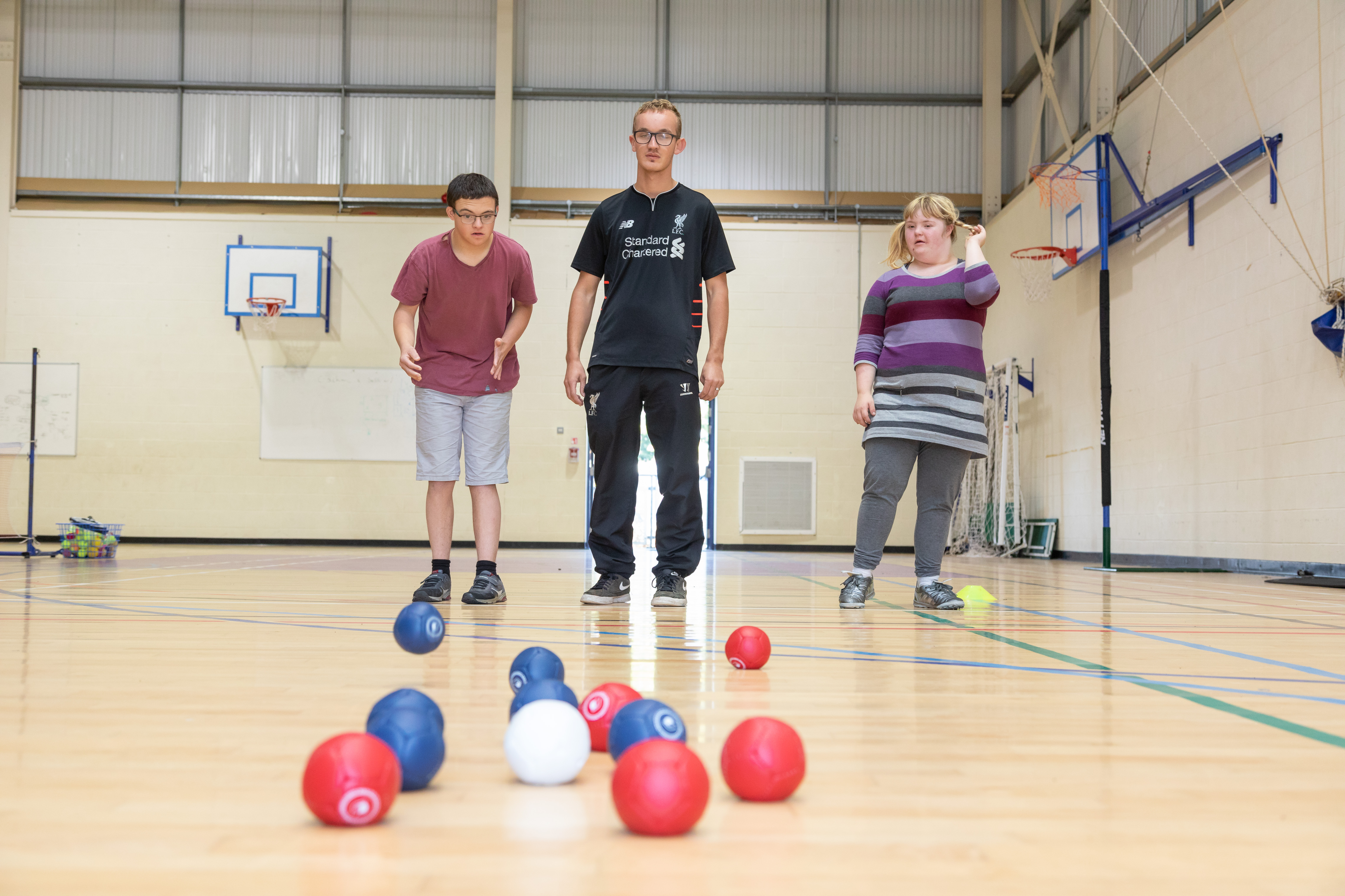Learning opportunities students playing bowls in the Sports Hall.