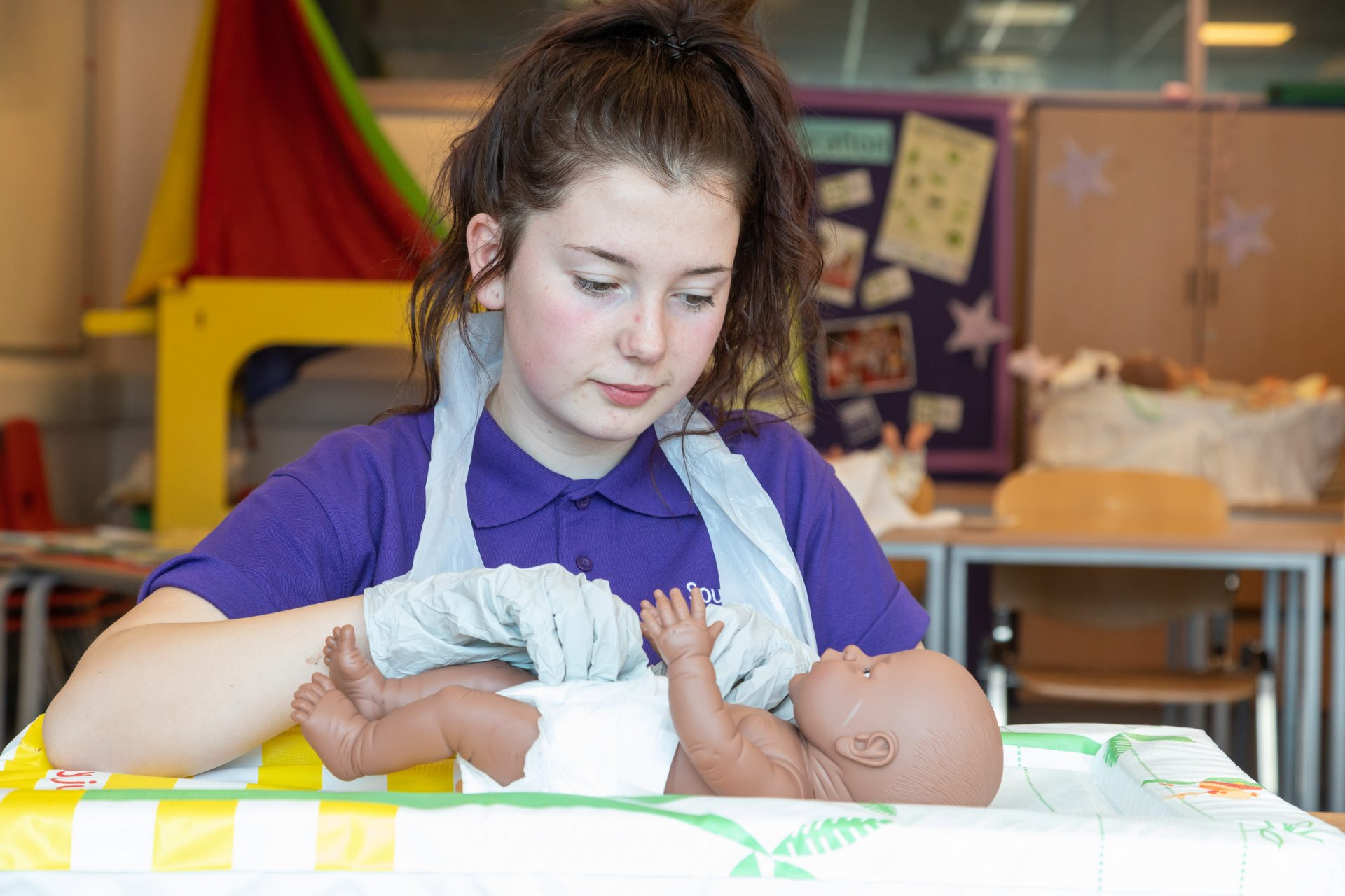 Childcare student with baby.