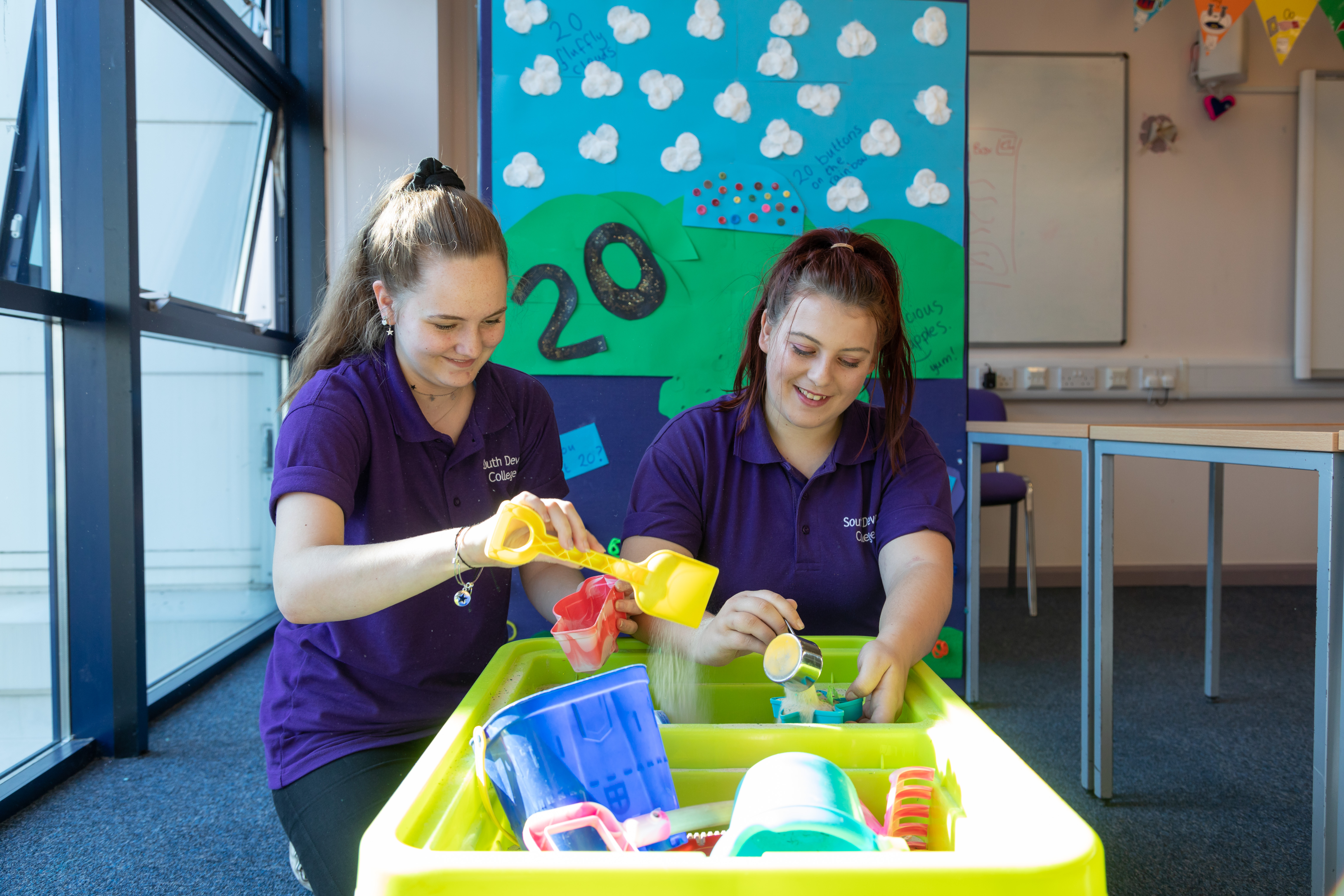 Childcare students in play pit.