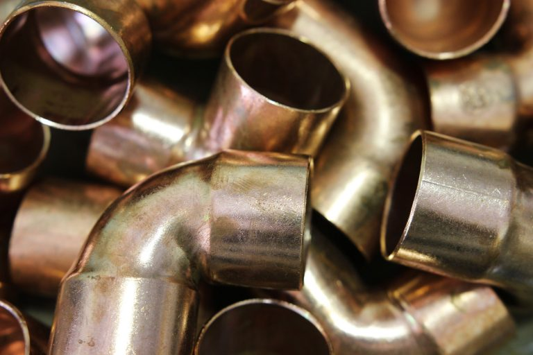 Close up image of copper pipes.