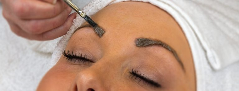 Client having their eyebrows tinted.