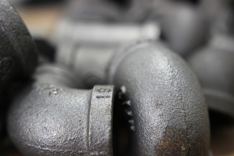 Close up image of iron pipes.