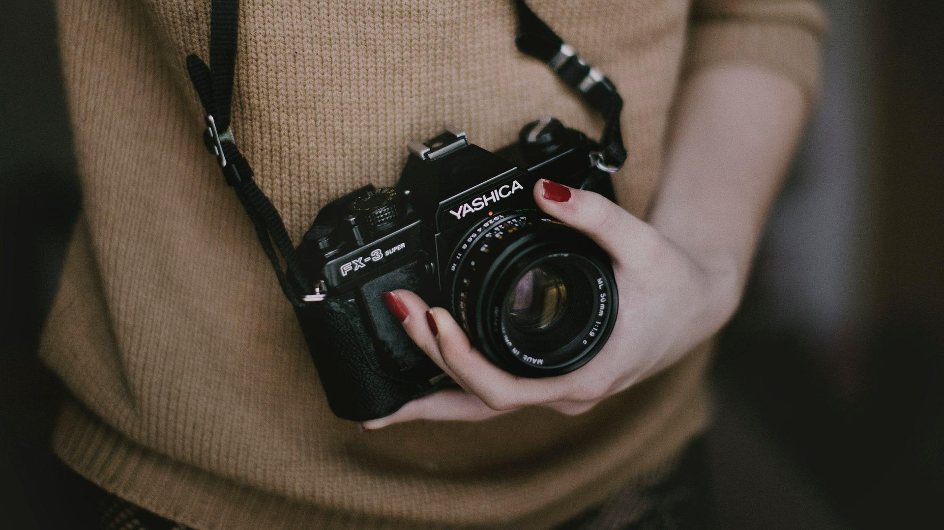 Photographer holding camera.