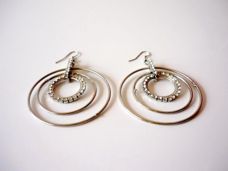 Silver earrings.