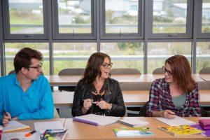 Child development students sat around a table.