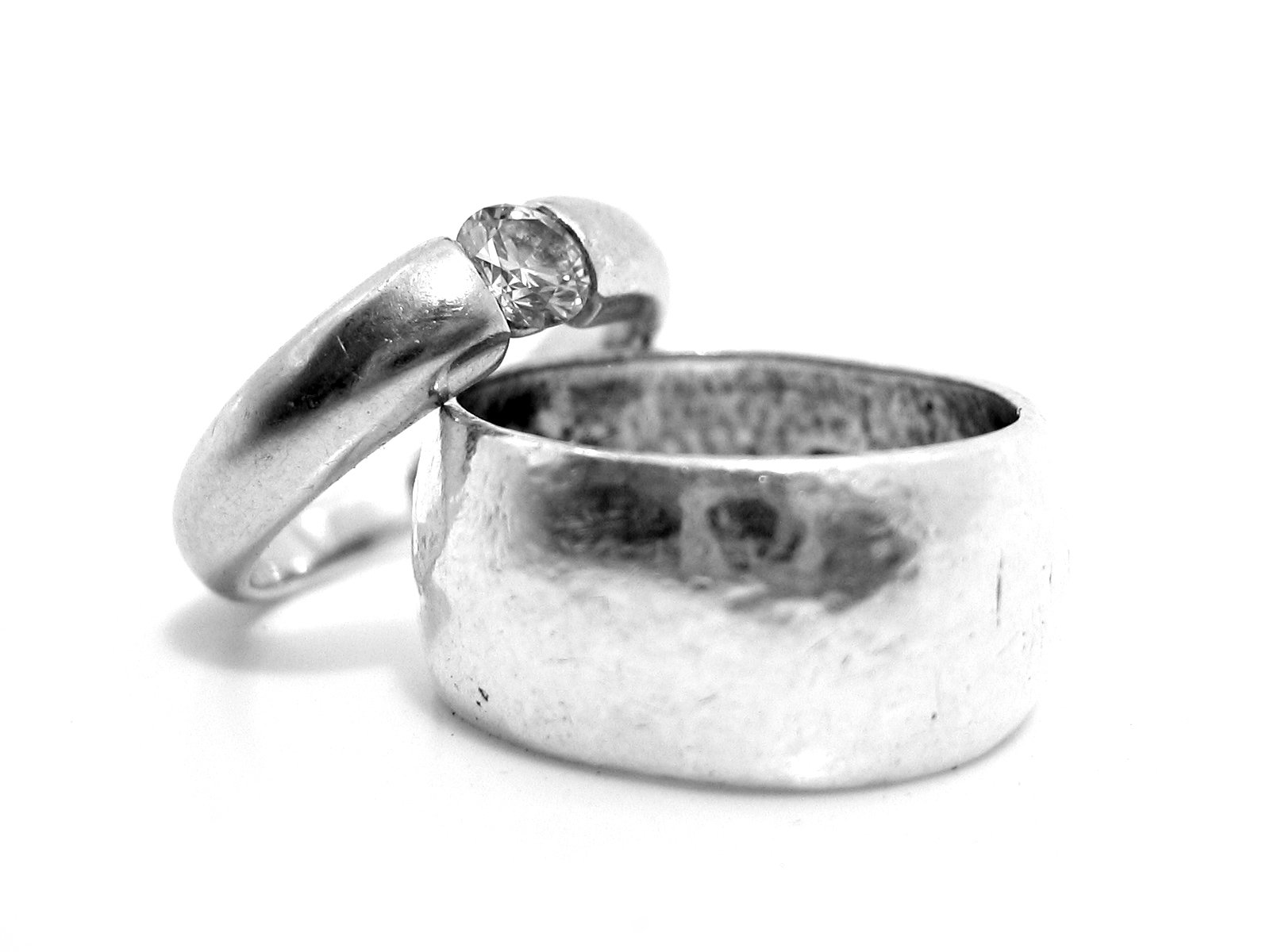 Close up of two silver rings.