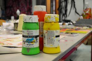 Art supplies on table.