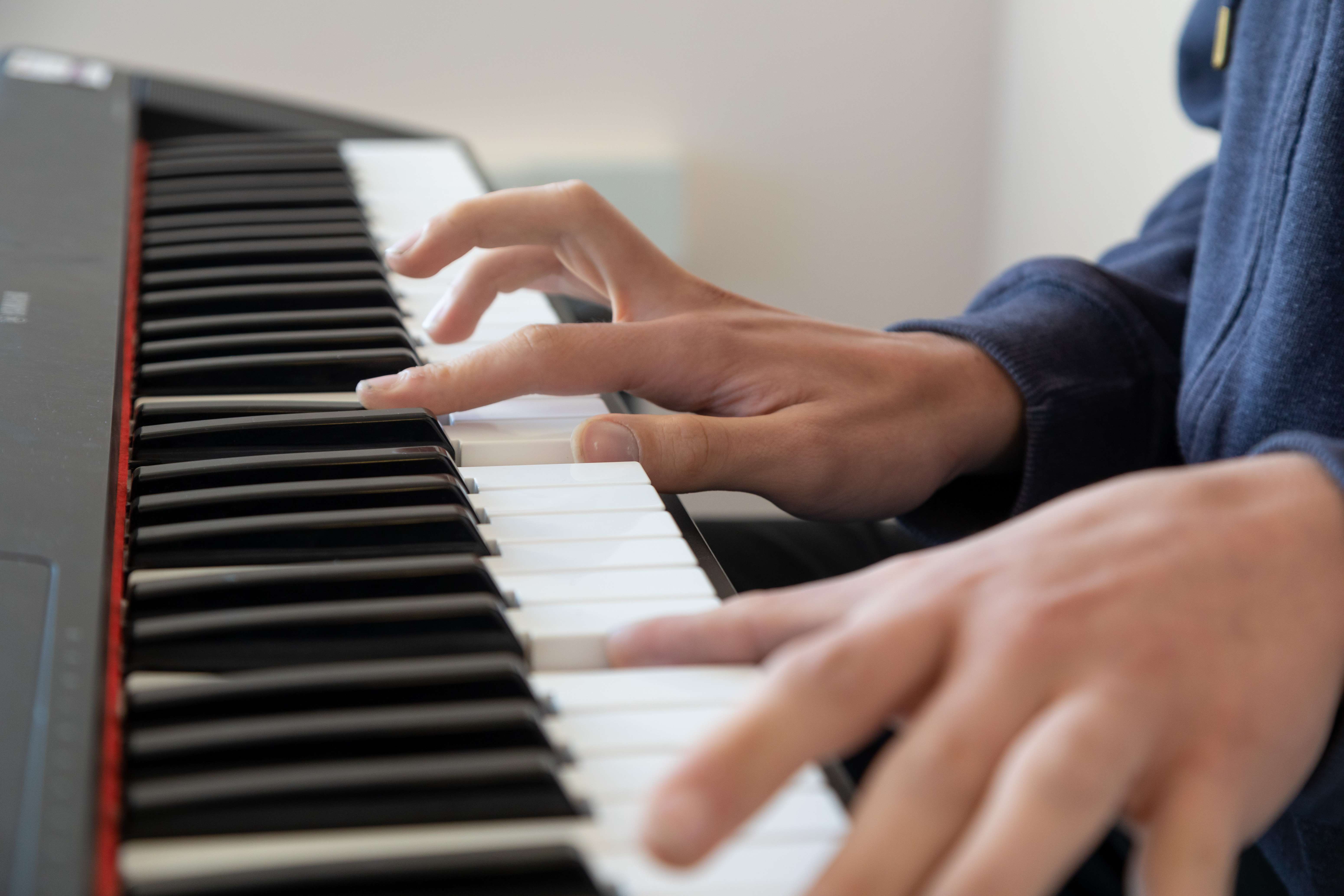 Music student playing the keyboard.