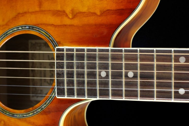 Acoustic guitar close up.
