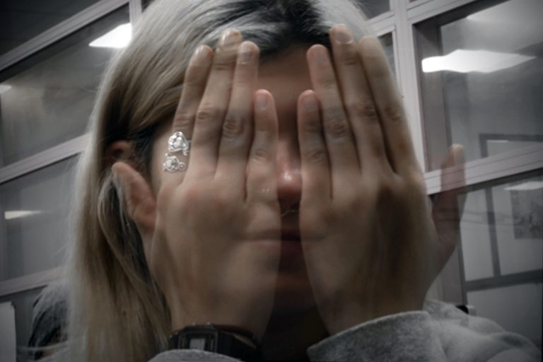 girl with hands in front of face