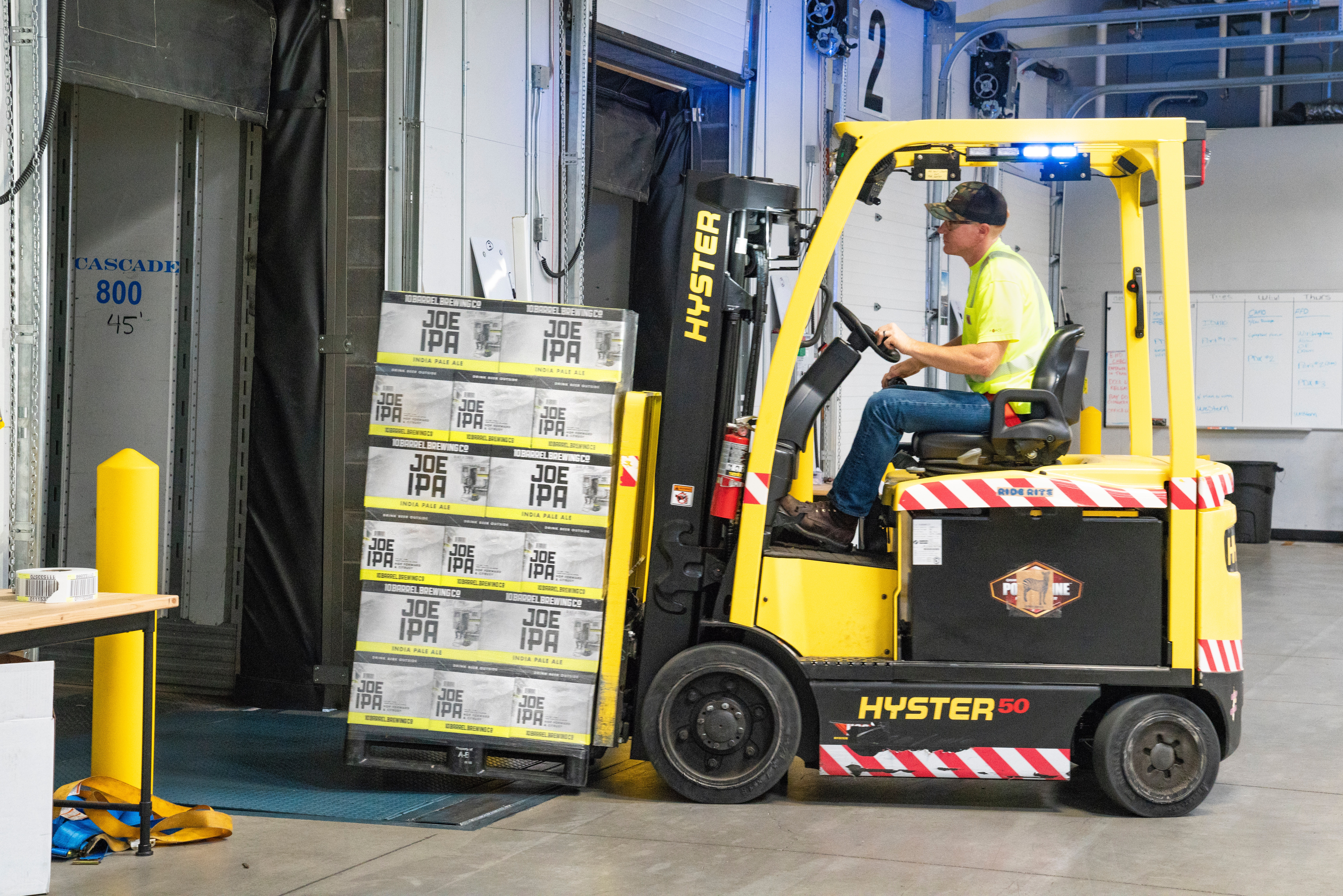 Person operating a forklift.