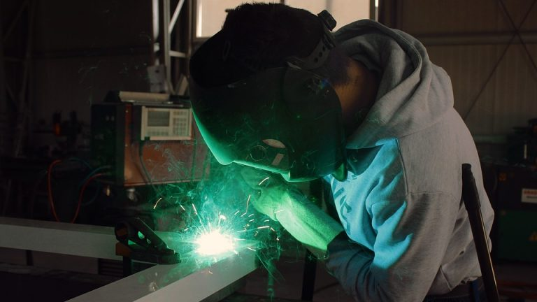 Welding student with mask.