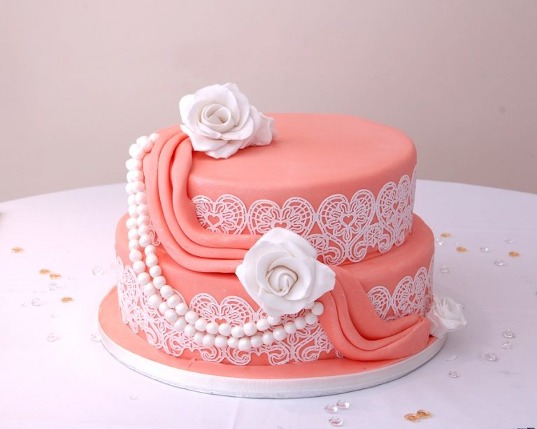 Pink cake decorated with icing.