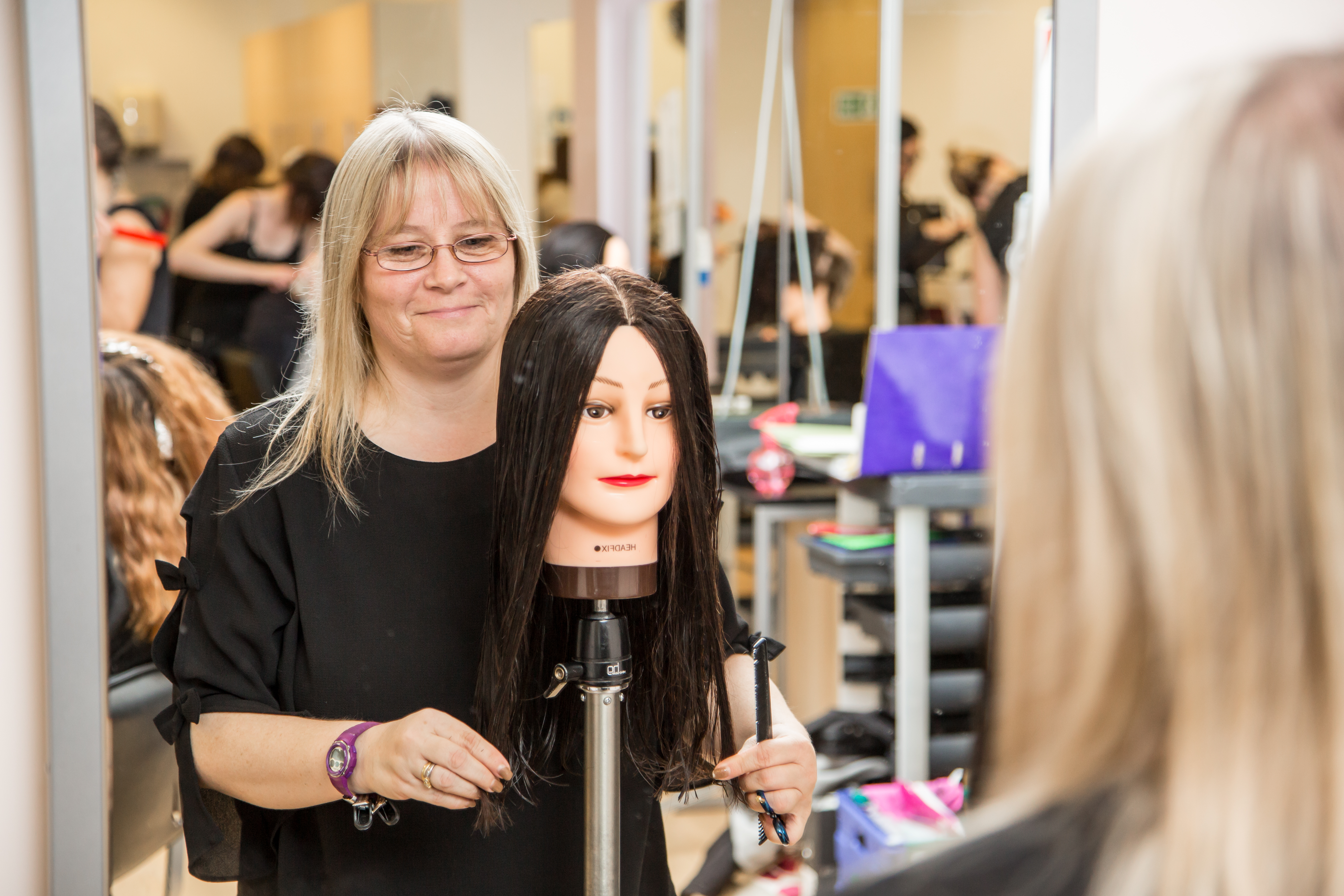 Adult hairdressing student.