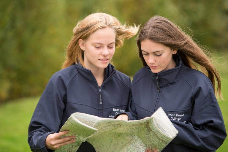 Two female public services students map reading.