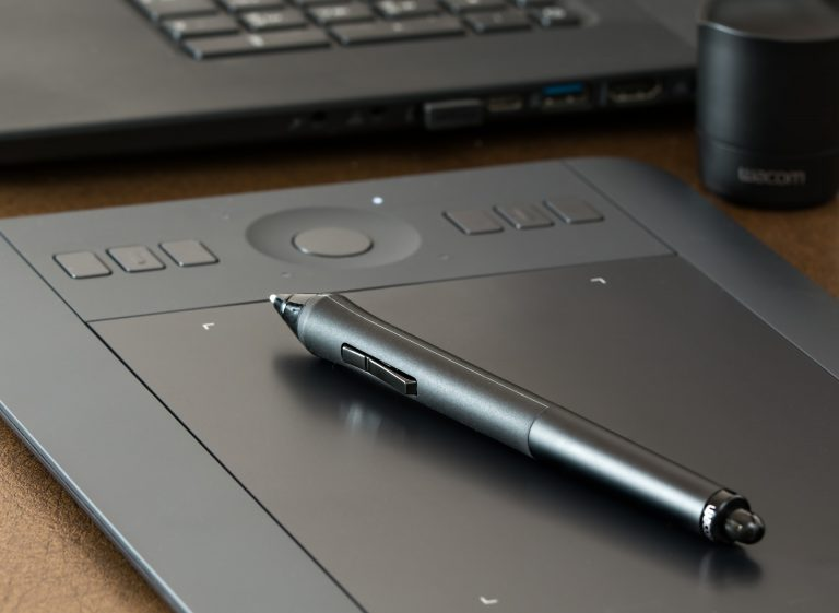 Graphics tablet on table.
