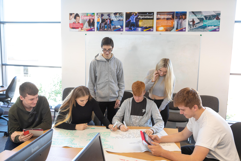 Generic students at desk.