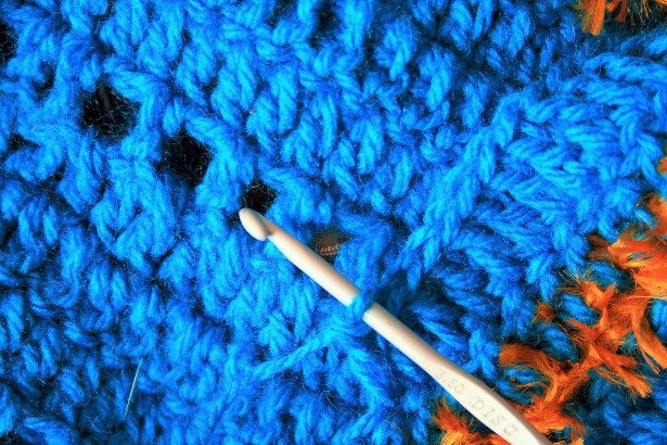 Close up image of crochet needle.