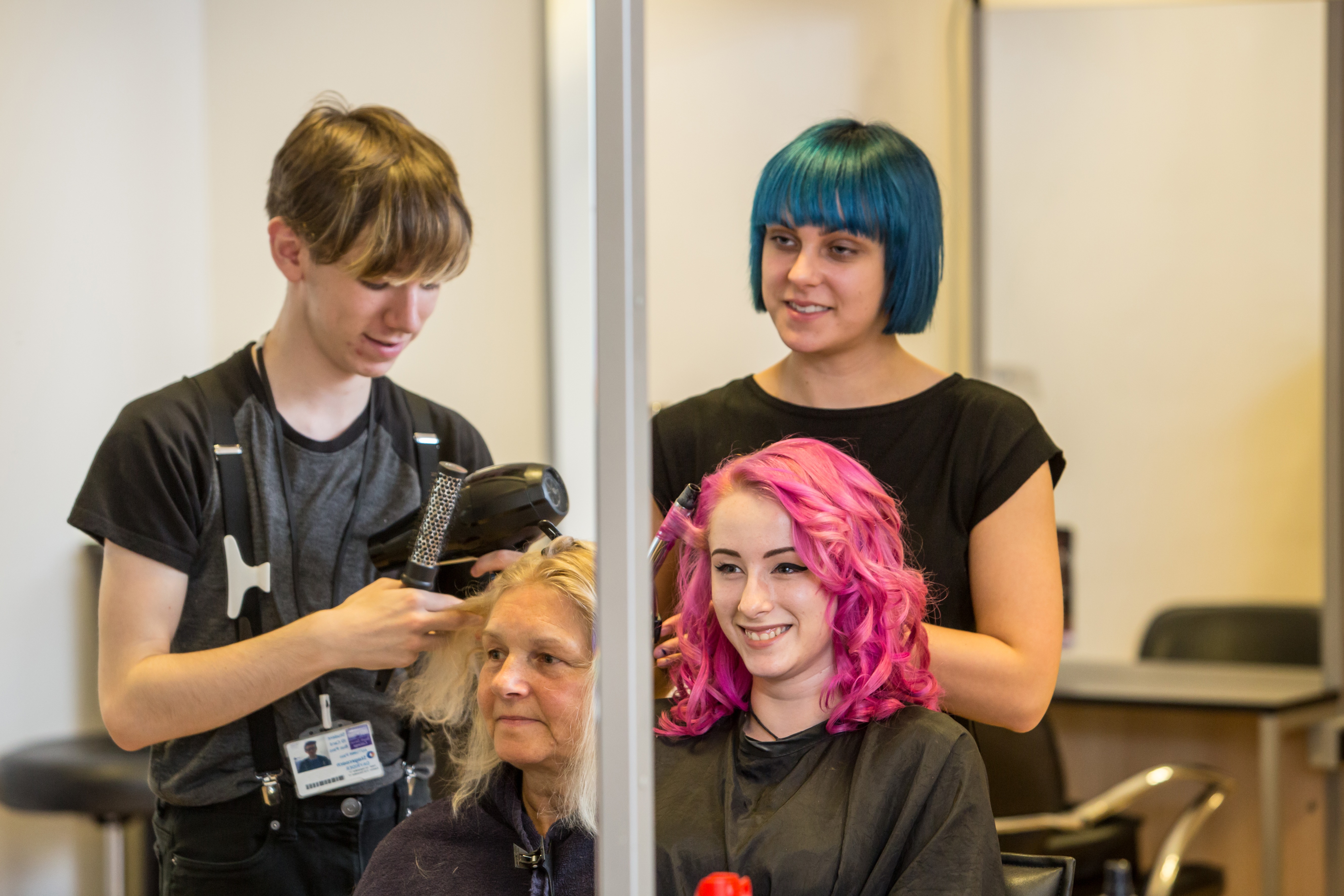 Students working on clients hair in the salons at South Devon College.