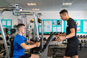 Two students training in the gym.