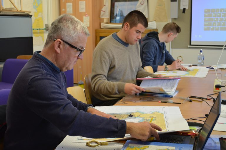 Higher education marine students in classroom.
