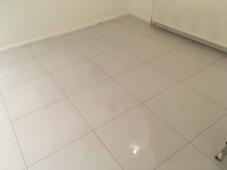 Polished white floor tiling.