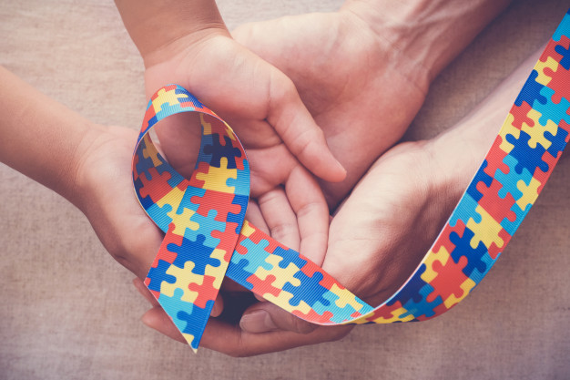Picture of a colourful autism awareness ribbon