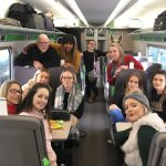 Group of School of Law students on a train at the start of a trip to London.