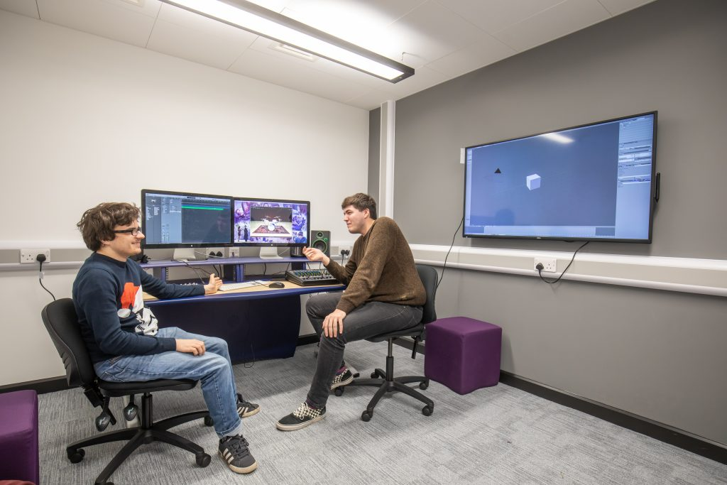 Two students in a classroom in the Hi Tech & Digital Centre
