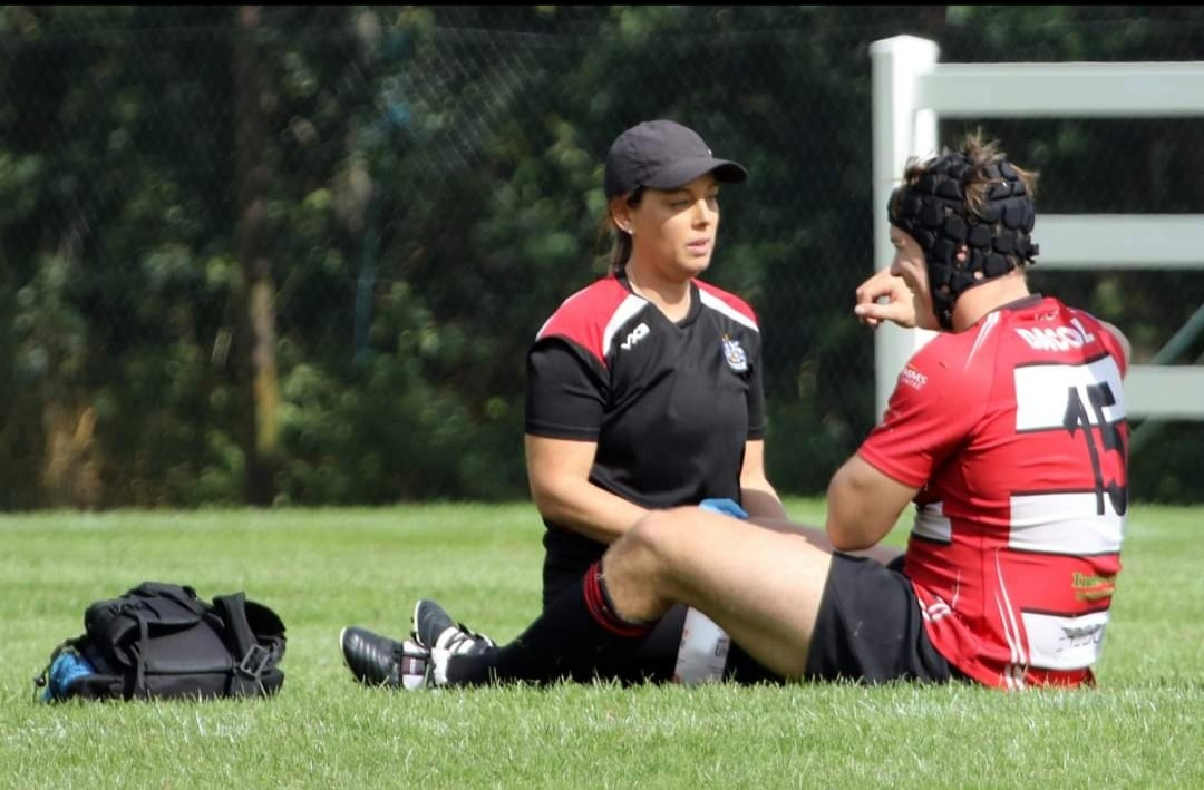 Kerry Mitchell sports therapist helping rugby player